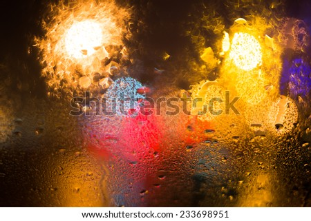 Rainy day in the city at night, view from the car window - stock photo