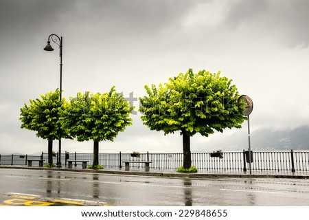 Rainy day on the narrow streets around Lake Como in Northern Italy. Romantic, travel vacation, European and weather concept - stock photo