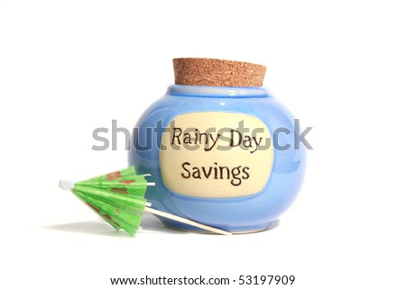 Rainy Day savings jar with umbrella - stock photo