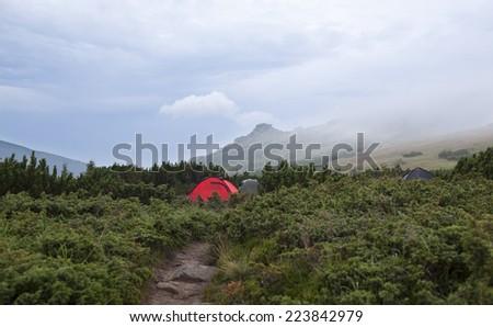 Rainy morning in camp, Carpathian mountains - stock photo
