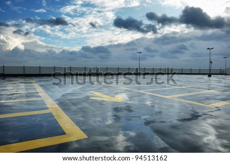Rainy rooftop parking - stock photo