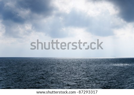 Rainy sky over the grey sea,. - stock photo