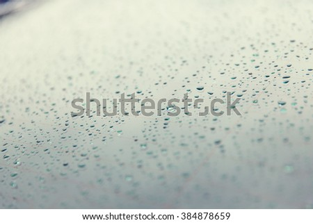 rainy weather and vehicles concept - close up of wet rear car glass