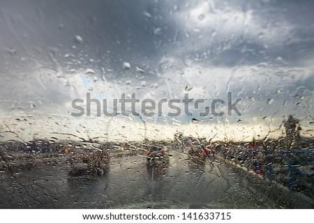 rainy window in traffic - stock photo