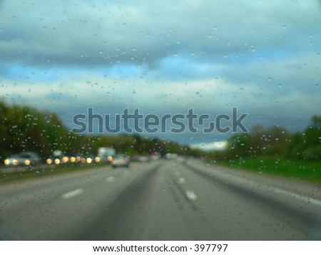 rainy windshield on the road - stock photo