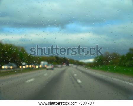 rainy windshield on the road - stock photo