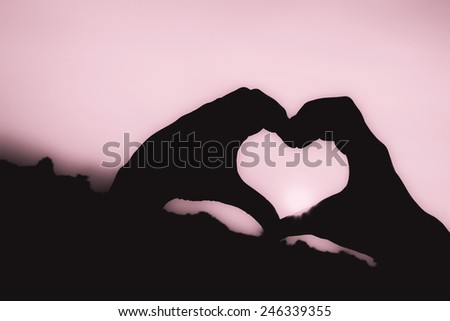 Raise hand show love symbol - stock photo