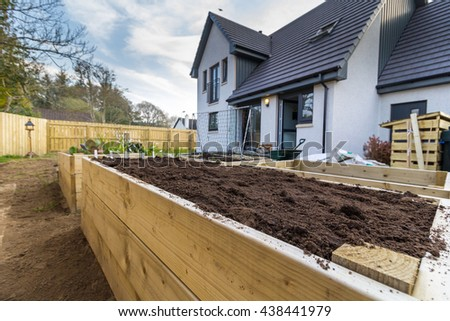 Raised bed in back yard or garden ready for planting