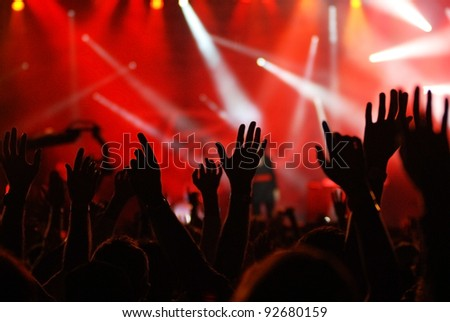 raised hands at concert - stock photo