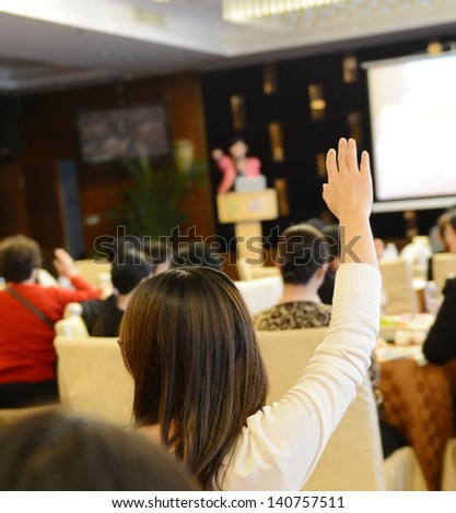 Raised hands in class of university  - stock photo