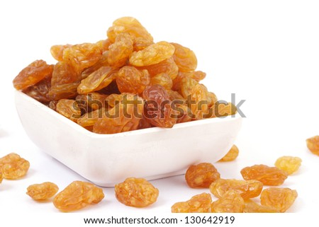 Raisin in a  bowl over white background - stock photo
