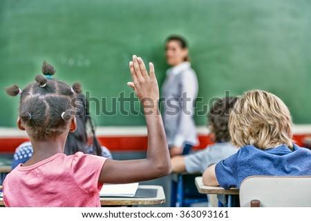 Raising hand at primary school. Success concept. - stock photo