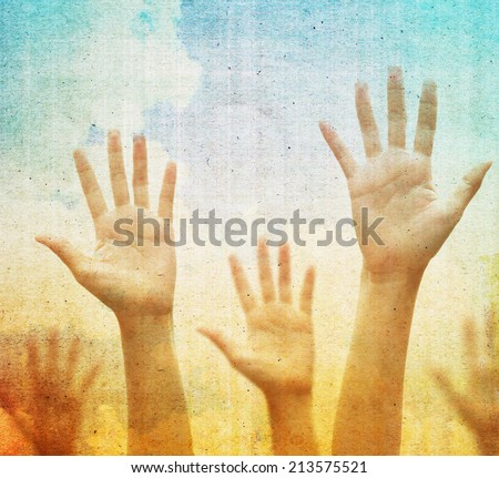Raising hands against vintage blue sky background. Filtered image. - stock photo