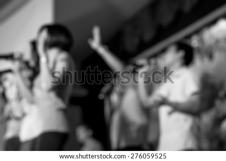 Raising hands to worship and praising in faith and belief for religion background  - stock photo