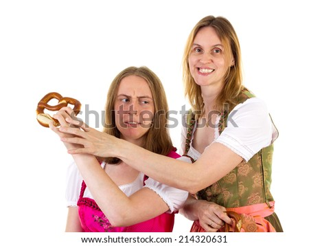 Raising quarrel because of pretzel - stock photo
