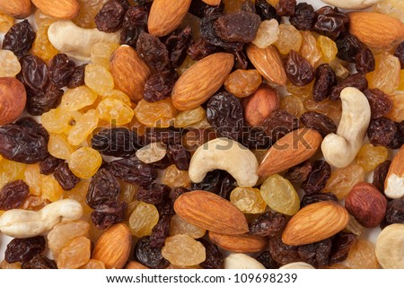 raisins and nuts background - stock photo