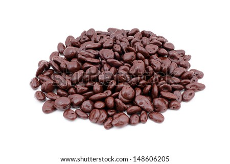 Raisins in chocolate isolated on white background. - stock photo
