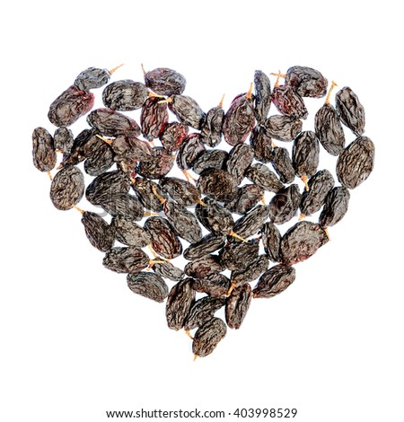 Raisins laid out in a heart shape. Isolated - stock photo