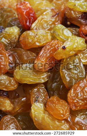 Raisins on white background - close-up - stock photo