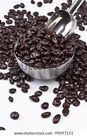 raisins with chocolate in metal bowl with ladle - stock photo