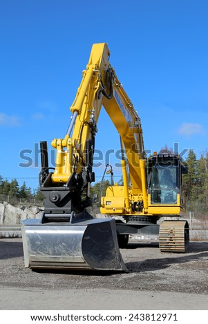 RAISIO, FINLAND - MARCH 22, 2014: Komatsu crawler excavator on a yard. A crawler excavator or digger is a vehicle designed to dig or move large objects, and is classified by its mode of locomotion. - stock photo
