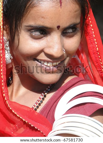 RAJASTHAN, INDIA - DEC 4 -Beautiful young Indian woman poses for her portrait  on Dec 4, 2009, in Rajasthan, India - stock photo