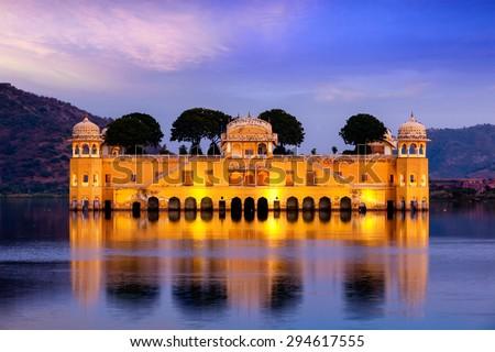 Rajasthan landmark - Jal Mahal (Water Palace) on Man Sagar Lake in the evening in twilight.  Jaipur, Rajasthan, India - stock photo