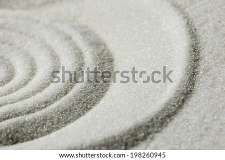 Raked sand background pattern and texture in a Japanese zen garden with concentric circles for meditation, tranquility and wellness. - stock photo