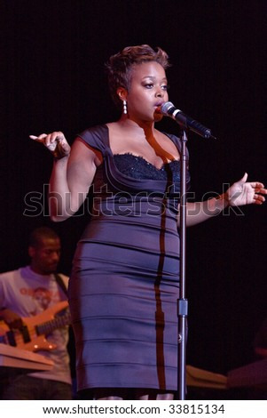 RALEIGH, NORTH CAROLINA-JUNE 28: Chrisette Michele performs on stage at Raleigh Memorial Convention Hall on June 28, 2008in Raleigh, North Carolina. - stock photo