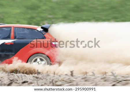 Rally car in dirt track