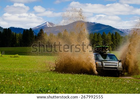 Rally Car Puddle Splashing  - stock photo