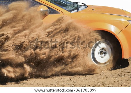 Rally car turning in track  - stock photo
