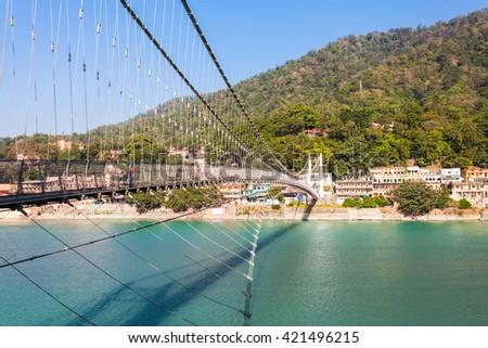 Ram Jhula is an iron suspension bridge situated in Rishikesh, Uttarakhand state of India. - stock photo