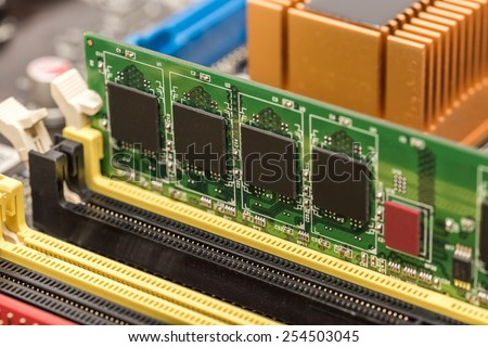 RAM Memory Module Installed On Computer Motherboard - stock photo