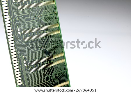 Ram memory seen from below. The golden path to the green circuit board. - stock photo