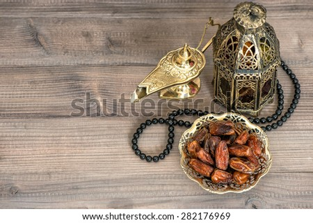 Ramadan decoration. Dates, arabian lantern and rosary. Islamic holidays concept - stock photo