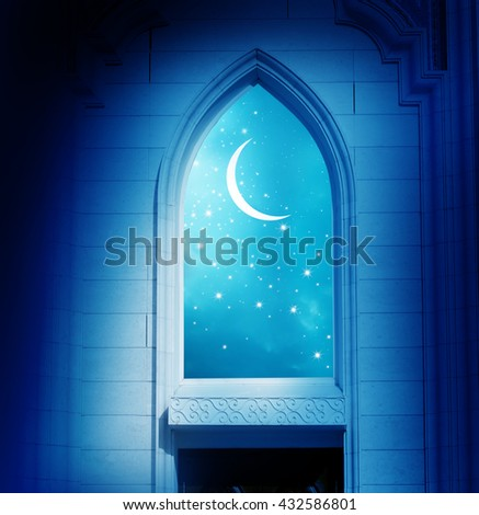 Ramadan Kareem background.Mosque window with shiny crescent moon