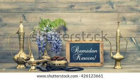 Ramadan kareem. Golden oriental decorations and islamic rosary beads.  Vintage style toned picture - stock photo