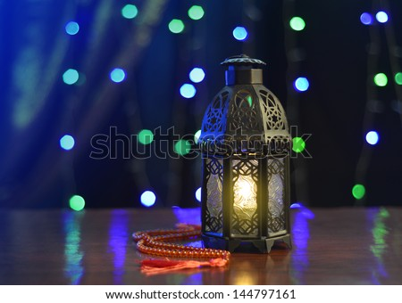 Ramadan lantern against christmas lighting background - stock photo
