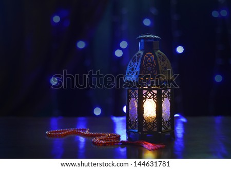 Ramadan lantern and rosary on dark background - stock photo