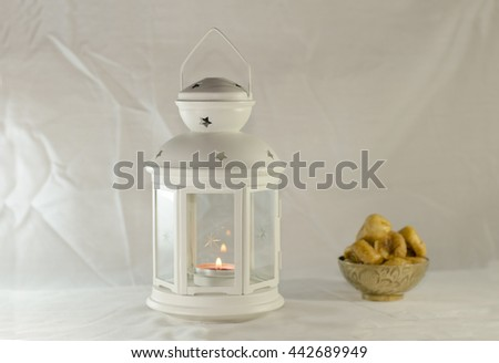Ramadan Lightened Lantern with Dried figs delicious in copper bowl - stock photo