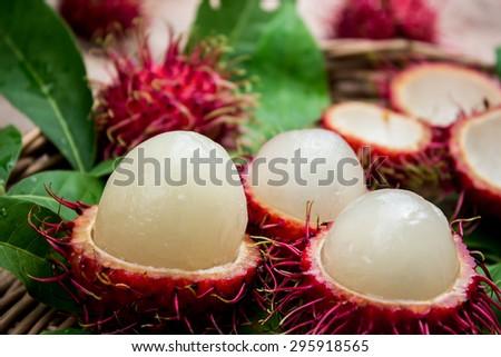 Rambutan peeling in the basket - stock photo