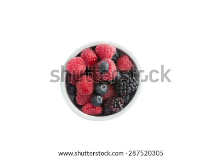 Ramekin of fresh fall or autumn berries with whole juicy ripe blueberries, blackberries and raspberries for a healthy breakfast, snack or dessert or to be used as cooking ingredients, overhead view  - stock photo