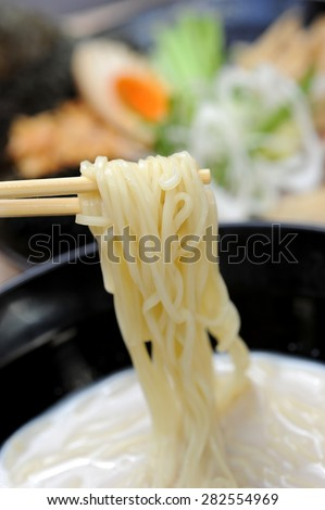 Ramen noodle tonkotsu soup holding with chopstick - stock photo
