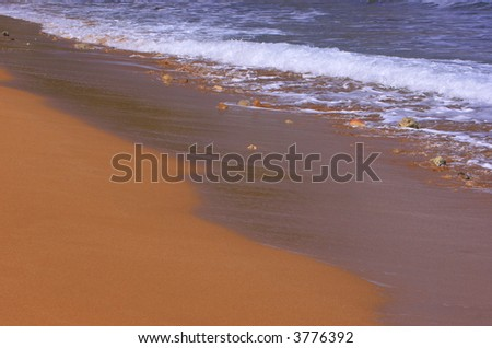 Ramla Bay - Malta's most picturesque beach famed for its red fine sand and blue Mediterranean waters - stock photo