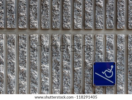Ramp Access Sign for the Disabled on Concrete Wall - stock photo
