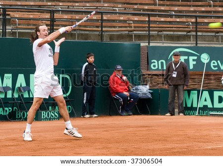 RANCAGUA, CHILE - SEPTEMBER 17: Nicolas Massu of Chile plays during the training session before the match against Austria during the Davis Cup on September 17, 2009 in Chile. 78, 2009 in Chile.