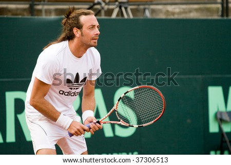 RANCAGUA, CHILE - SEPTEMBER 17: Nicolas Massu of Chile plays during the training session before the match against Austria during the Davis Cup on September 17, 2009 in Chile.