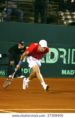 RANCAGUA, CHILE - SEPTEMBER 18: Nicolas Massu of Chile runs in the court in the against Jurgen Melzer of Austria during the Davis Cup on September 18, 2009 in Chile.