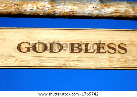 ranch gate sign on blue background with words God Bless - stock photo
